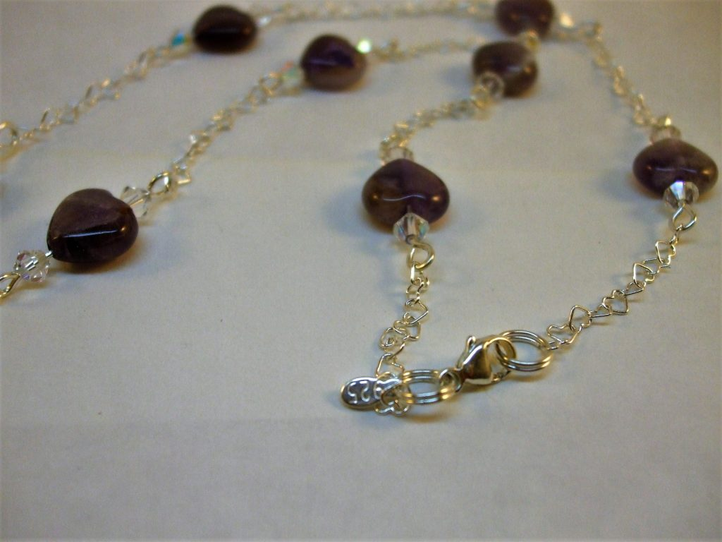 Sterling Silver heart chain, amethyst hearts pendant bead & beads highlighted with swarovski bicone beads. Pendant is set with sterling silver bail, sterling silver claw clasp hallmarked & with sterling silver tag...$69 - NK007ss